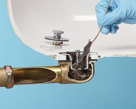 Photo of a clogged drain in need of plumbing services